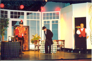 Zangler (Dave Williams), Melchior (Colin Pile) and Waiter (Simon Jackson) at The Imperial Gardens Cafe